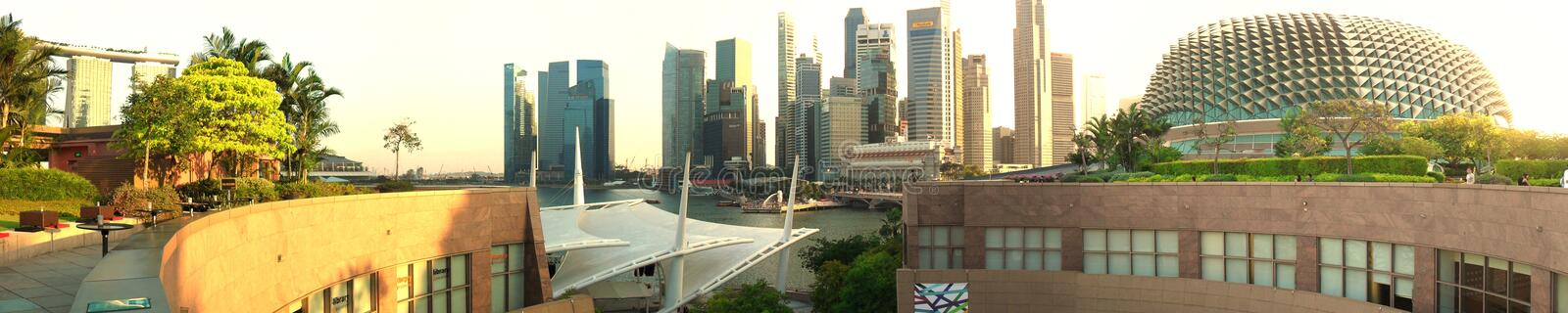 Singapore skyline at sunset - a view from rooftop. Singapore City Skyline at Sunset Panorama. Shot taken from a rooftop bar stock images