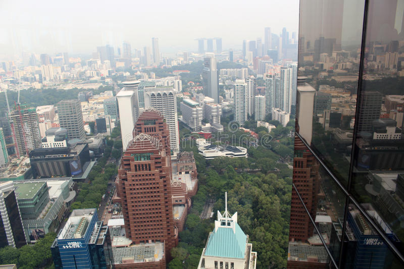 Singapore Skyscrapers. SINGAPORE/SINGAPORE - CIRCA NOVEMBER 2015: View of the Singapore skyscrapers from the top of the ION Sky shopping center in Orchard Road stock image