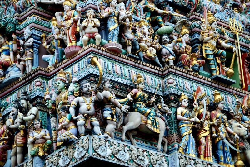 Singapore: Sri Veeramakaliamman Hindu Temple. Detail of the many carved figures adorning the gopuram Sikhara entrance tower at the Sri Veeramakaliamman Hindu royalty free stock photos
