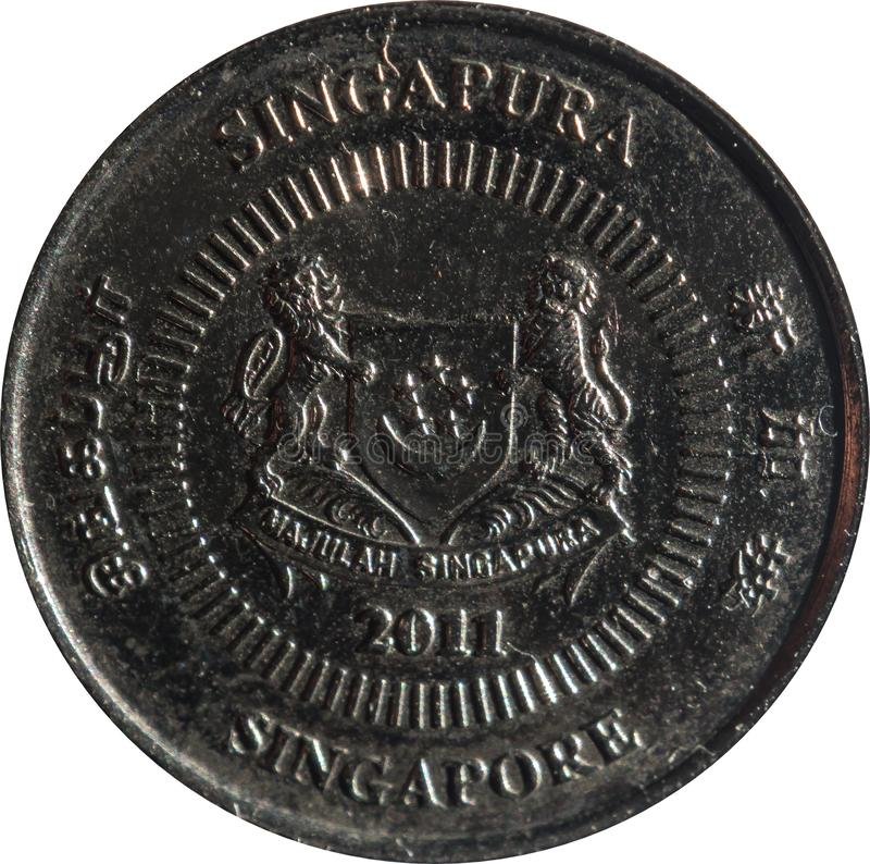 Singapore ten-cent coin features Emblem with date underneath and `Singapore` on four sides in English, Tamil, Chinese, and Malay. Singapore ten-cent coin stock image