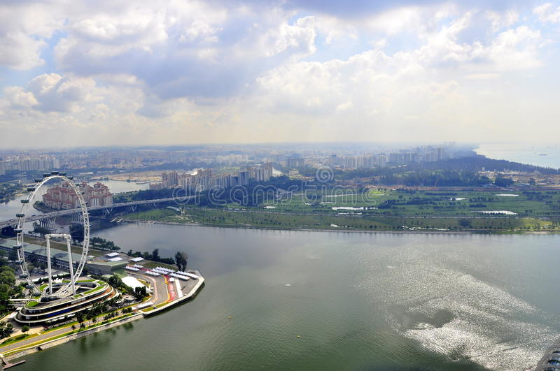 Singapore view over port and Eye, ferris wheel royalty free stock images