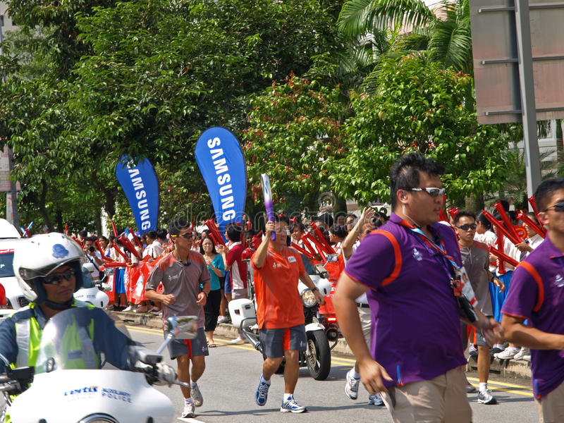 Download Singapore Youth Olympics 2010 Flame Procession Editorial Stock Photo - Image: 15562878