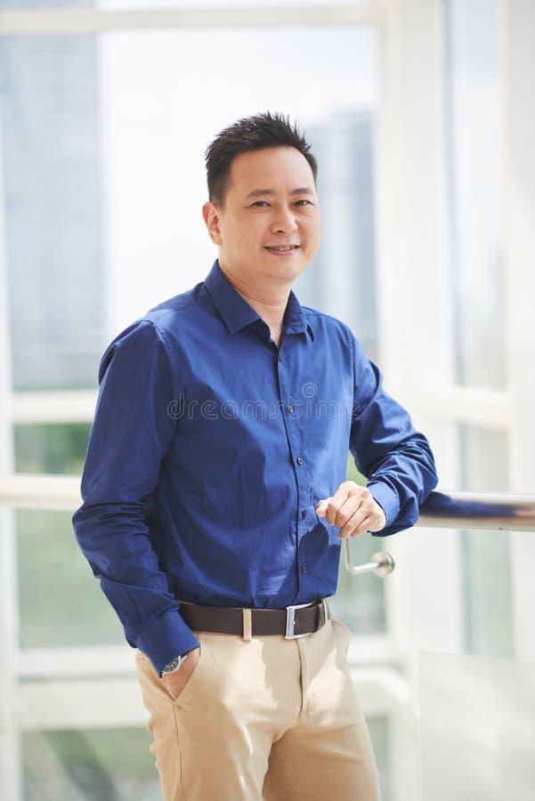 Singaporean zakenman stock afbeeldingen