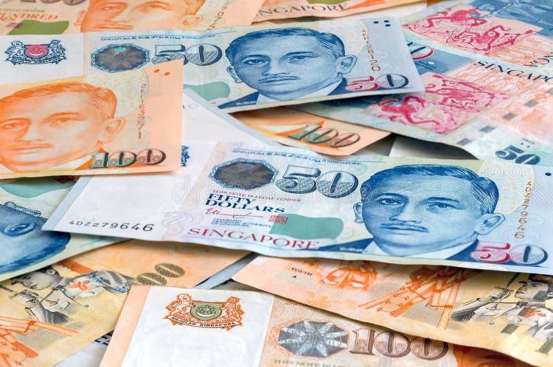 Singapour cent et fond de billets d'un dollar de Fifity image libre de droits