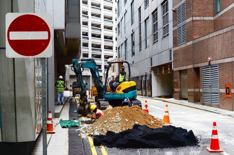 Singapur drogowi pracownicy załatwia problem zdjęcie royalty free
