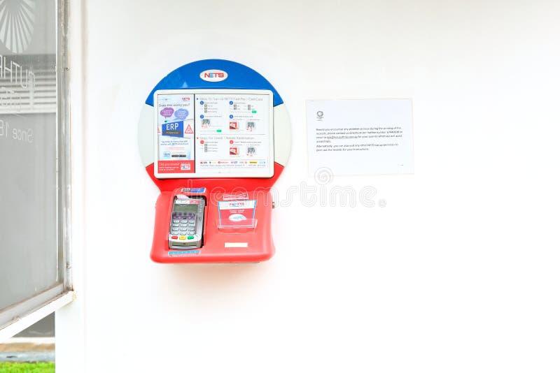 Singapur: SIECI samoobsługi stacje i dopełniają maszyny zdjęcie stock