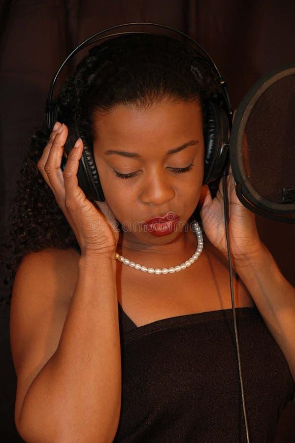 Singer. Female singer royalty free stock photo