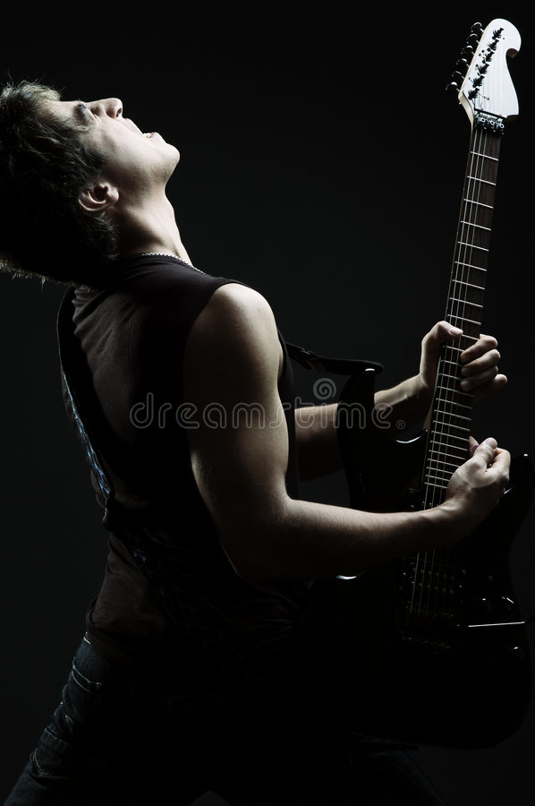 Singer in the darkness. Young singer in the darkness royalty free stock photos