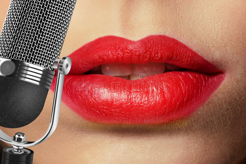 Singer. Glamour singer girl with retro microphone stock photography