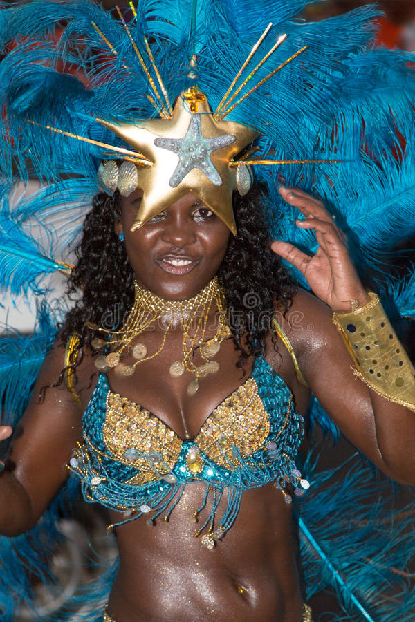 Singer in a group of dancers perform in the annual Carnival stock images