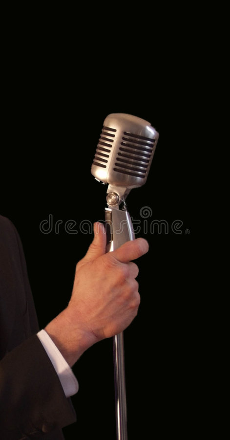 Free Singer Holding Vintage Microph Royalty Free Stock Photography - 1378557