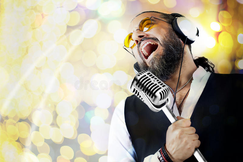Singer man with microphone stock photos