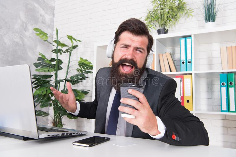 Singer or manager. Office manager sing karaoke using coffee cup. Manager enjoy singing during coffee break. Project. Manager make music fun in office royalty free stock images