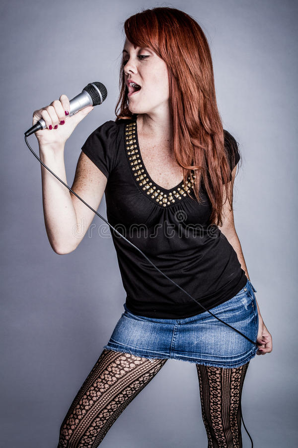 Singer with Microphone royalty free stock photos