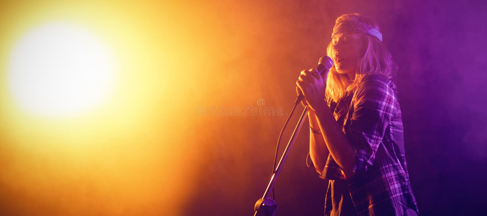 Singer performing at concert. Female singer performing at concert in nightclub stock photos