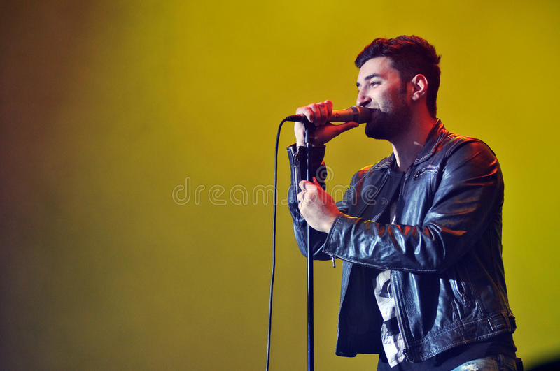 Singer Performing Live With Yellow Background Editorial Image