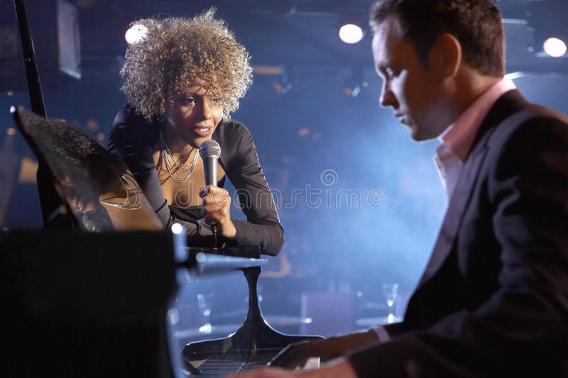Singer And Pianist On Stage Stock Photos