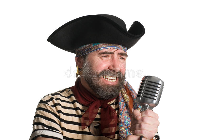 Singer Pirate Sings In An Old Microphone. Stock Photography