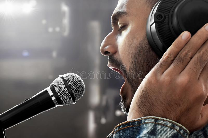 Singer recording song in studio. Singer recording a song in studio royalty free stock image