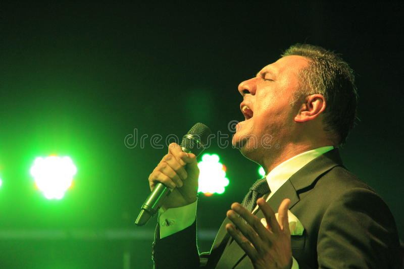 Singer sings in a outdoor concert. Renowned Indian film actor Boman Irani sings in honor of martyred defense persons in terrorist attack in Mumbai, India royalty free stock image