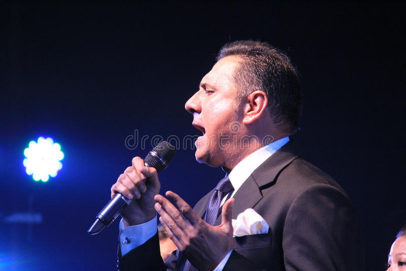 Singer sings in a outdoor concert. Renowned Indian film actor Boman Irani sings in honor of martyred defense persons in terrorist attack in Mumbai, India royalty free stock photos