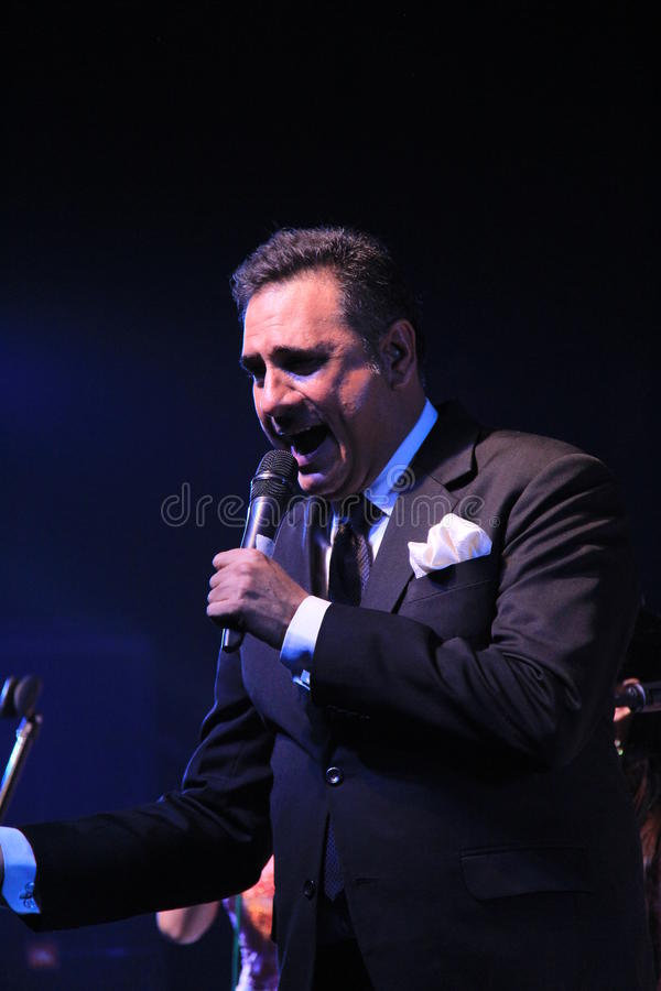 Singer sings in a outdoor concert. Renowned Indian film actor Boman Irani sings in honor of martyred defense persons in terrorist attack in Mumbai, India stock image
