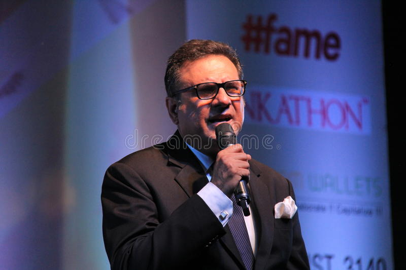 Singer sings in a outdoor concert. Renowned Indian film actor Boman Irani sings in honor of martyred defense persons in terrorist attack in Mumbai, India stock photos