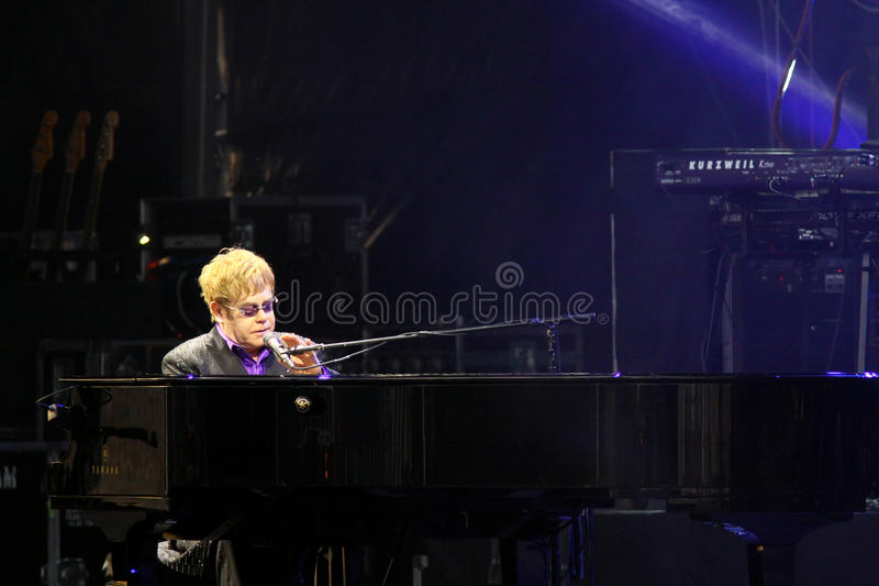 Singer Sir Elton John performs onstage. KYIV, UKRAINE - JUNE 30, 2012: Singer Sir Elton John performs onstage during charity Anti-AIDS concert at the royalty free stock image