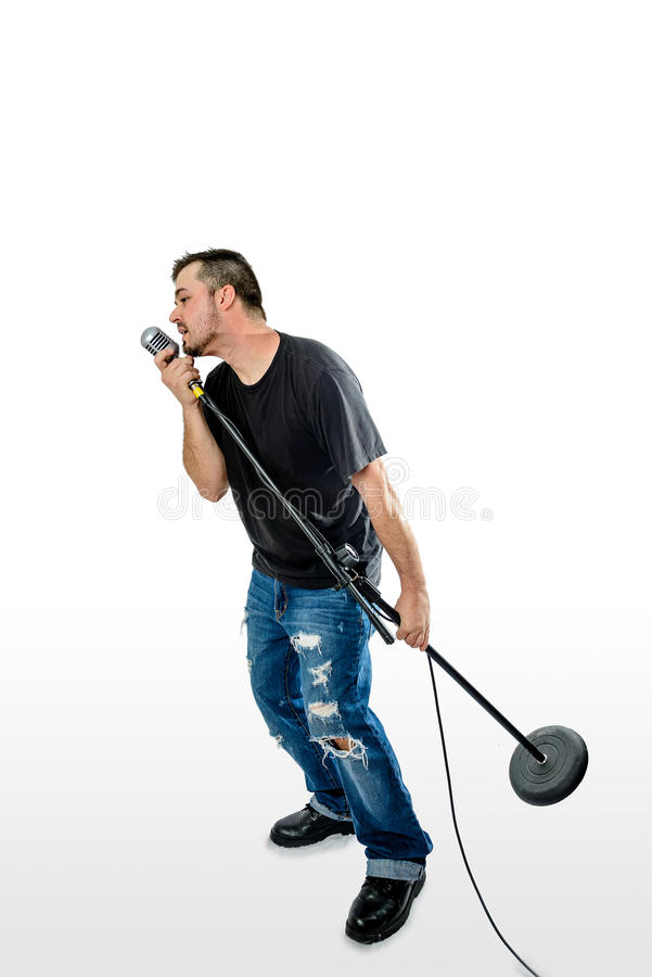Singer Vocalist on White leaning lifting mic stand royalty free stock photography