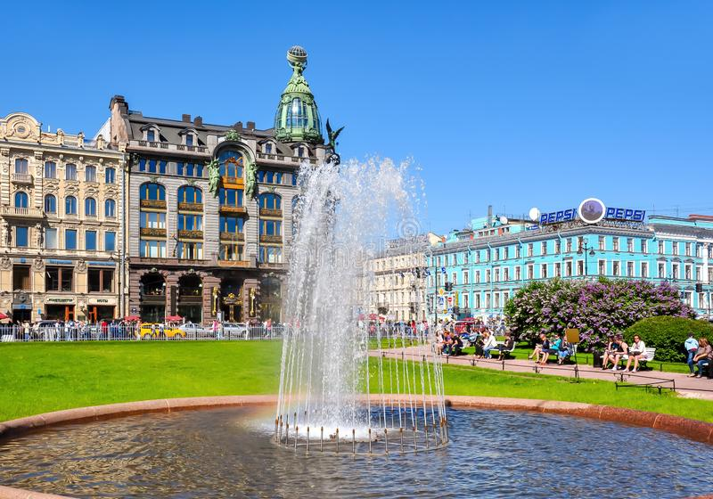Singer Zinger House on Nevsky prospect and fountain on Kazan square, St. Petersburg, Russia stock image