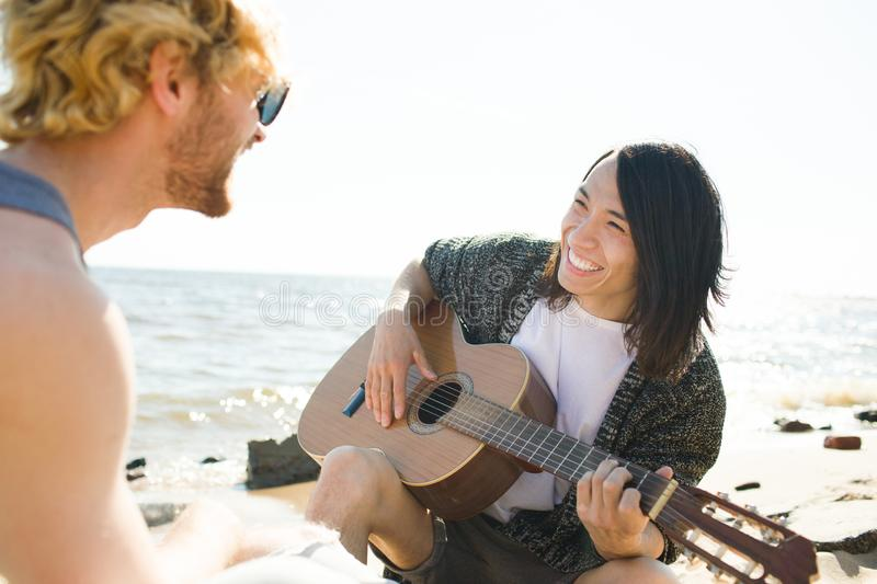 Singing on the beach royalty free stock image