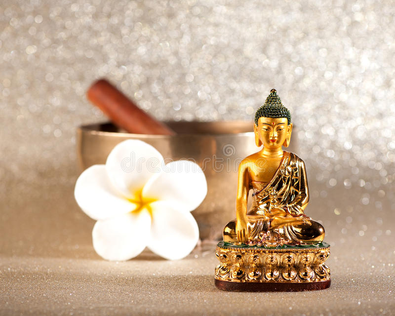 Singing Bowl and Buddha statue. Meditation concept stock photo