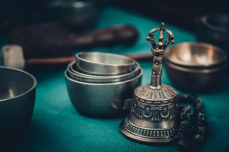 Singing bowls, bell and rosary for meditation royalty free stock image