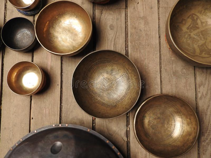 Singing bowls-Cup of life - popular mass product souvenir in Nepal, Tibet and India-stay on ethnic traditional wooden ornament.  stock image