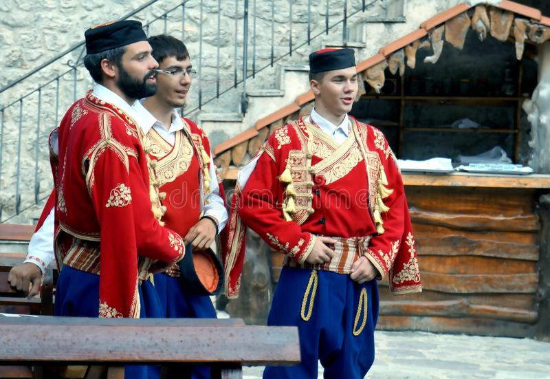 Singing boys. Beautiful dancers and singers at the nice folk style evening meal in Montenegro royalty free stock images
