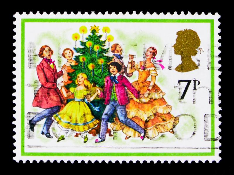 Singing Carols, Christmas 1978 serie, circa 1978. MOSCOW, RUSSIA - OCTOBER 3, 2017: A stamp printed in Great Britain shows Singing Carols, Christmas 1978 serie stock photography
