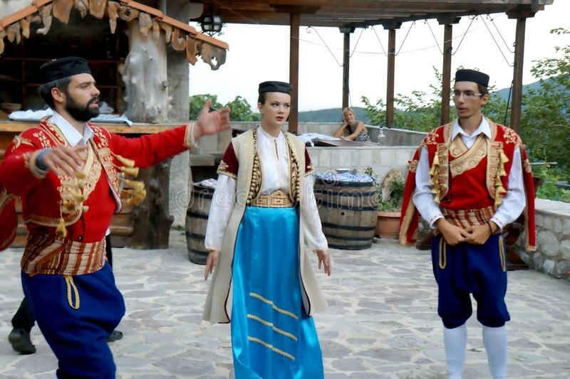 Singing and dancing. Beautiful dancers and singers at the nice folk style evening meal in Montenegro stock photo