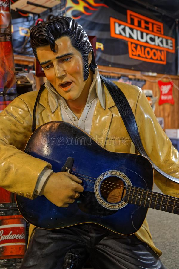Singing elvis in Knuckle Saloon, Sturgis. STURGIS, SOUTH DAKOTA, September 18, 2018 : An Elvis Presley statue seems to play guitar in a saloon of the town, with royalty free stock image