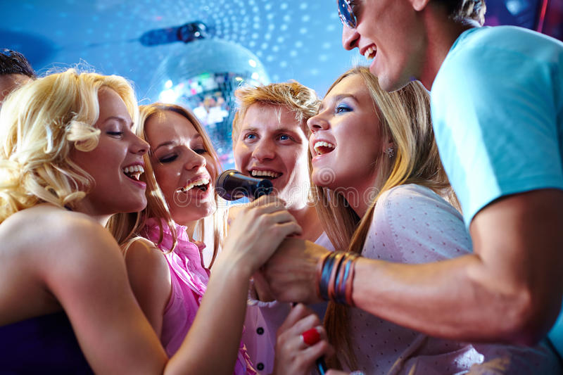 Singing friends royalty free stock photo