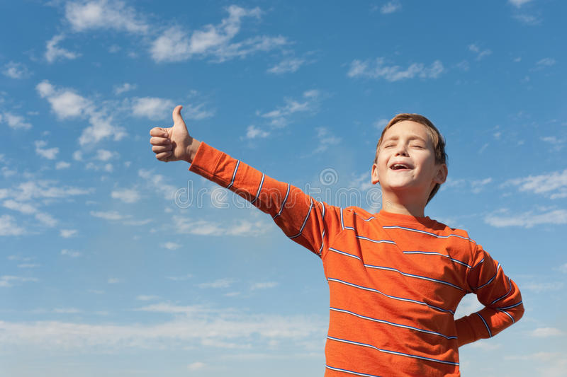 Download Singing Happy Boy In Front Of The Sky Stock Photo - Image of happy, cheerful: 18581942