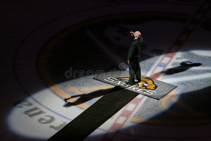 Singing the national anthems at an NHL hockey game stock photography