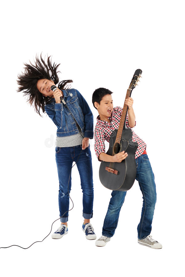 Singing siblings. Cheerful siblings performing together, isolated on white stock photos