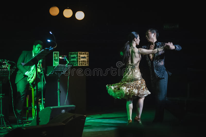 Singing on stage in dark studio. Peter Ong and Friends Concert at the Kuala Lumpur Performing Arts Centre royalty free stock photos