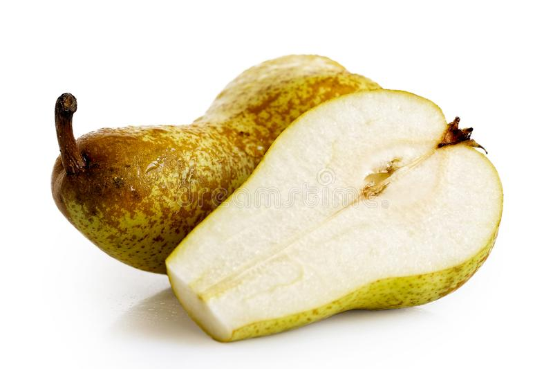 Single abate fetel pear next to a half of pear isolated on white royalty free stock images