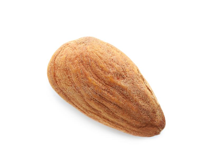 Single almond nut on white background stock images