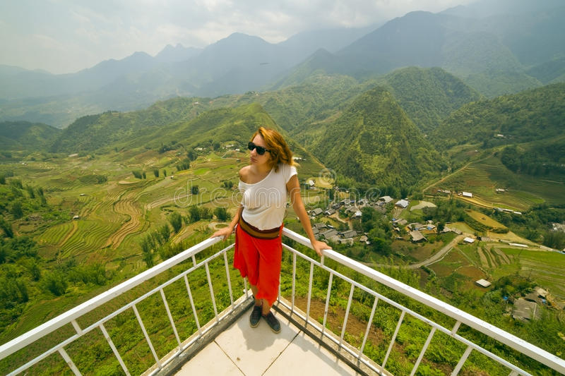 Single attractive woman on magnificent mountain view stock photography