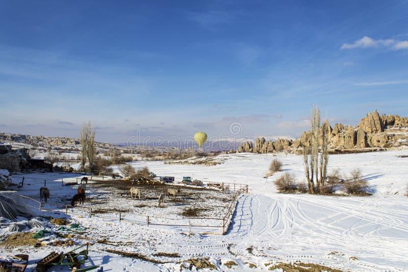Single ballon rising in cappadocia winter royalty free stock photos