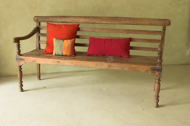 Single bench with cushions royalty free stock image