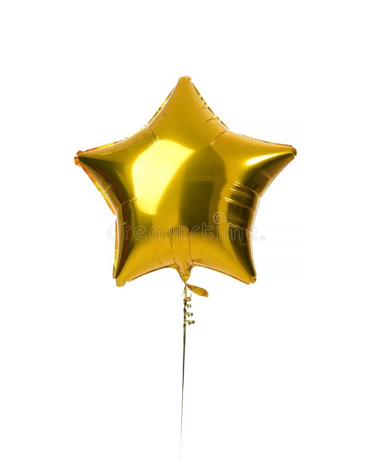 Single big gold star balloon object for birthday party stock images