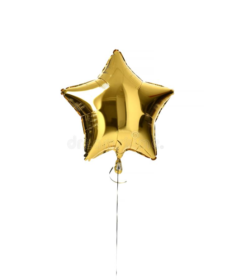 Single big gold star balloon object for birthday party stock photography